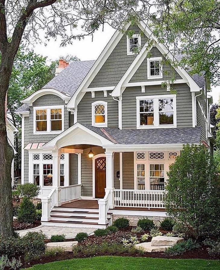 Grey farmhouse exterior with front porch