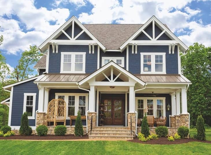 farmhouse exterior with blue walls double french door in wood finish and  white trim on windows