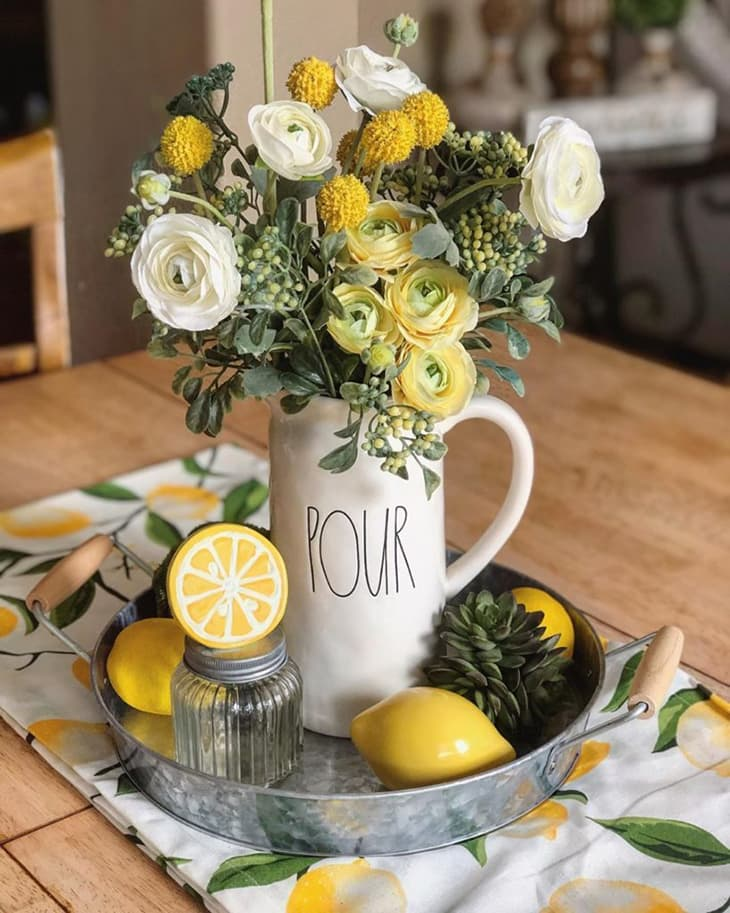 An image showing a lemon decorated small centerpiece, lemon decorated tray