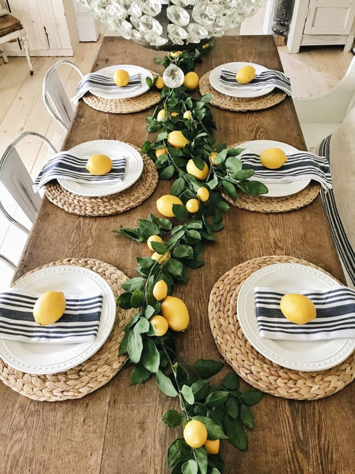 An image showing a dining table decorated with lemons