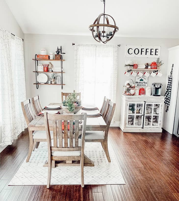 farmhouse dining room with rectangular table and 6 dining chairs and area rug