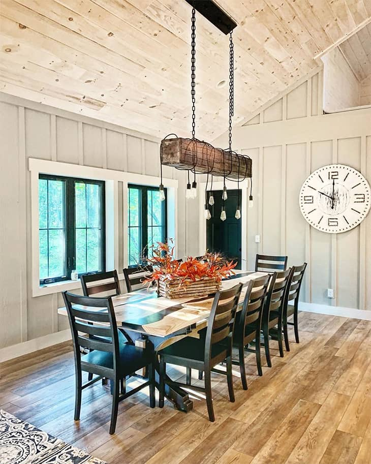 black dining room with big dining table and 10 chairs