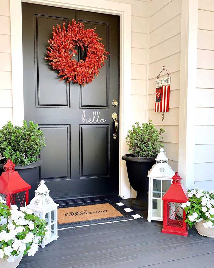 berry wreath on a black front door