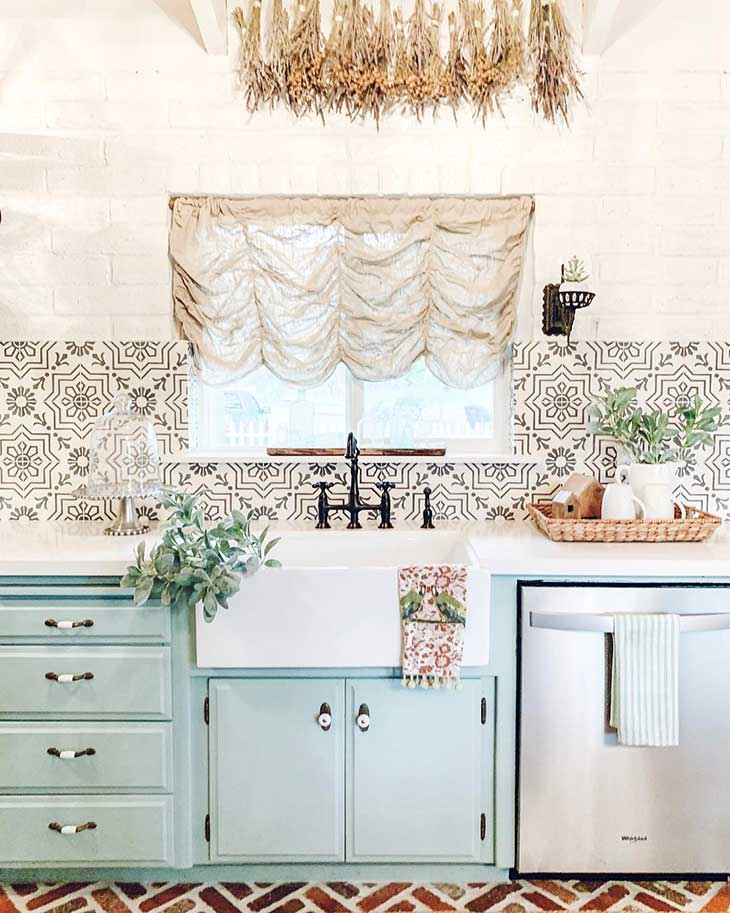 farmhouse sink on teal kitchen with print tiles