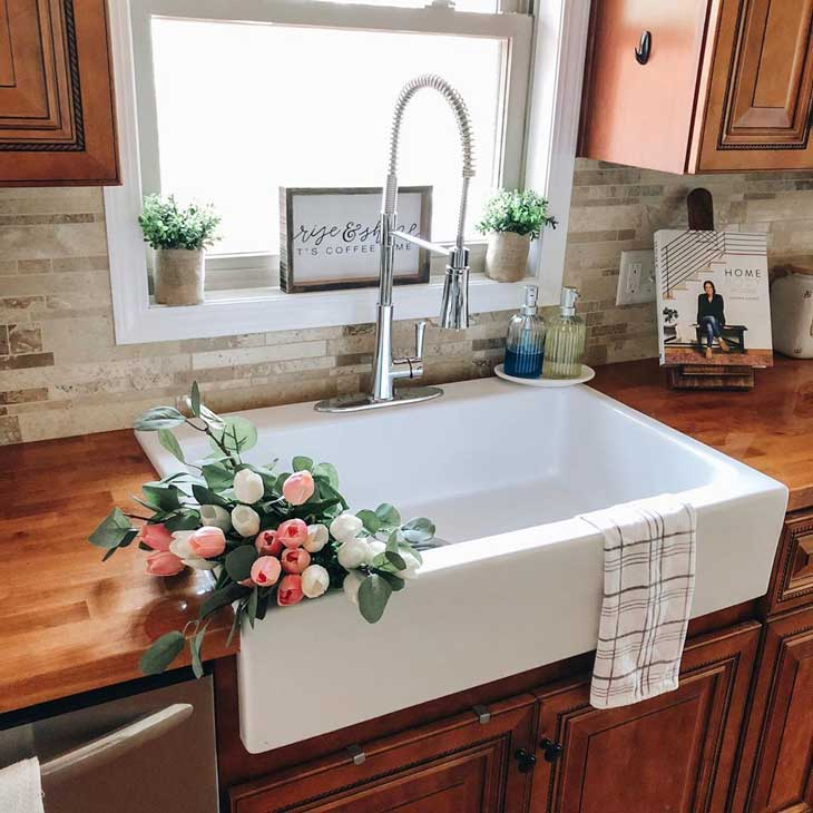farmhouse sink on wood kitchen