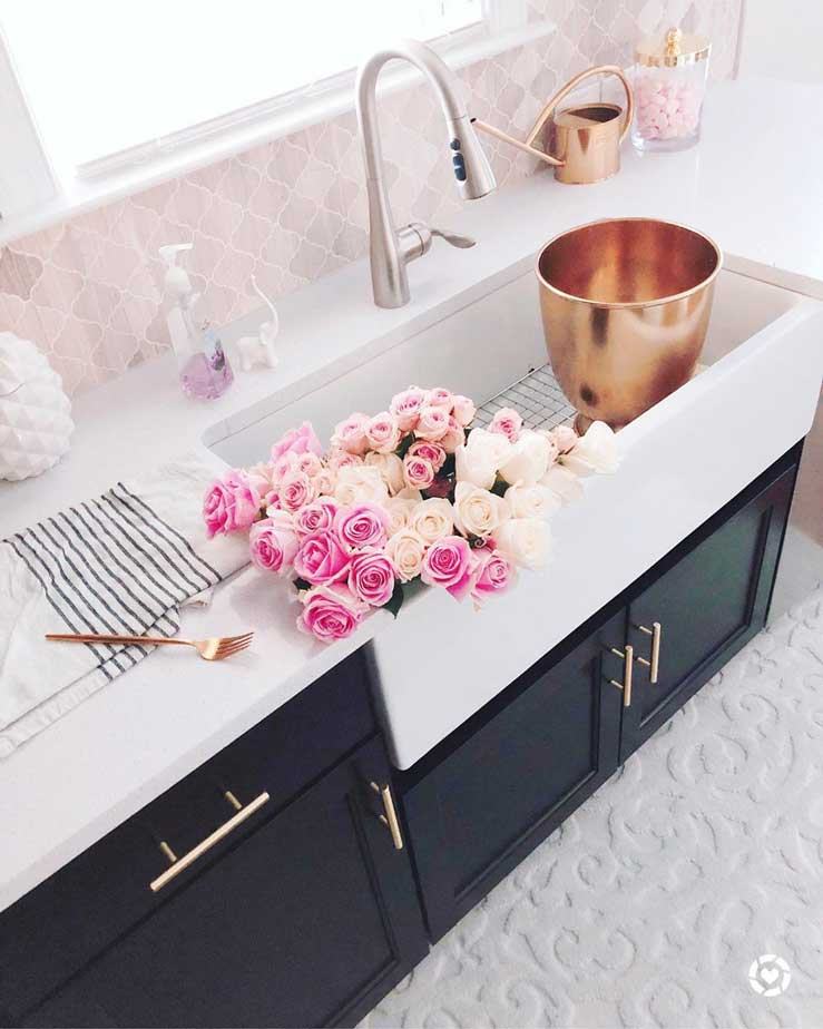 farmhouse sink on black kitchen with pink tiles