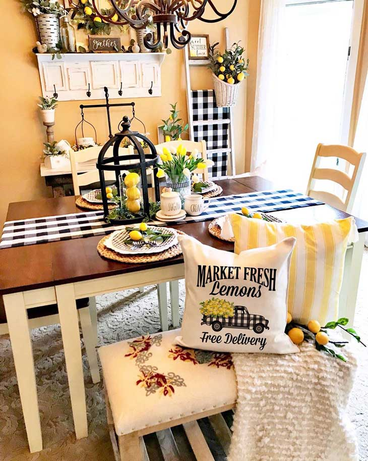 dining table with lemon decor and buffalo check runner and throw pillows