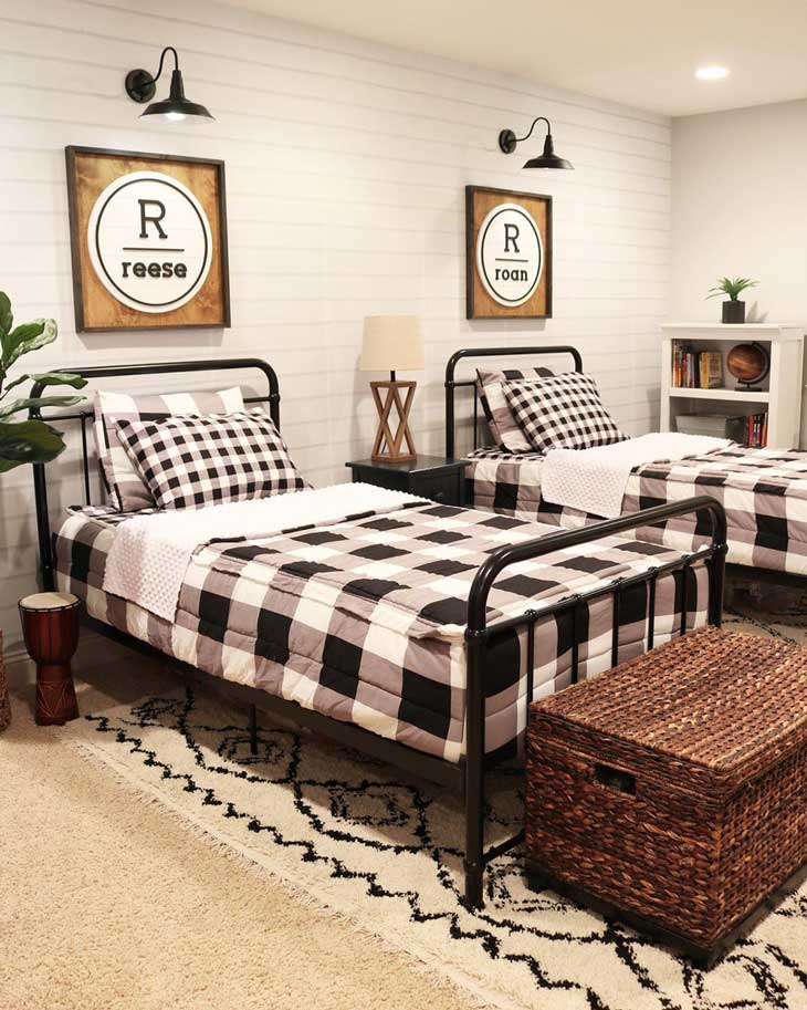 kids room with buffalo check bedding and metal beds