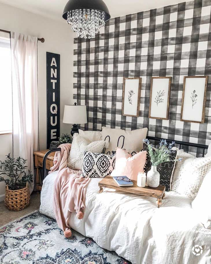 farmhouse kids room with buffalo check wallpaper and metal bed