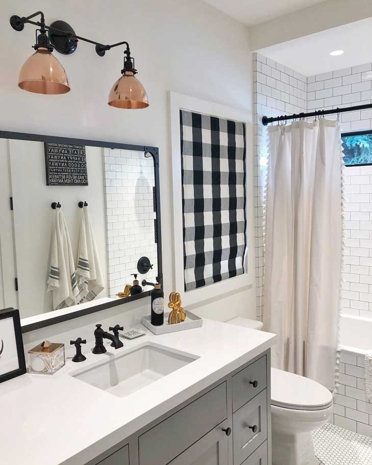 farmhouse bathroom with buffalo plaid decor, square mirror and black faucets