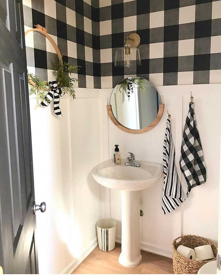 farmhouse half-bath with buffalo check wallpaper, round mirror