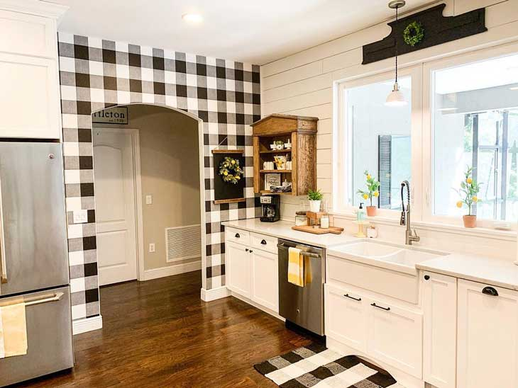 white farmhouse kitchen with buffalo check wall and shiplap
