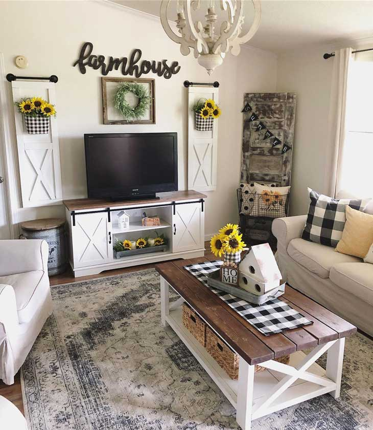 living room with farmhouse coffee table and tv stand, sunflowers decor and buffalo check