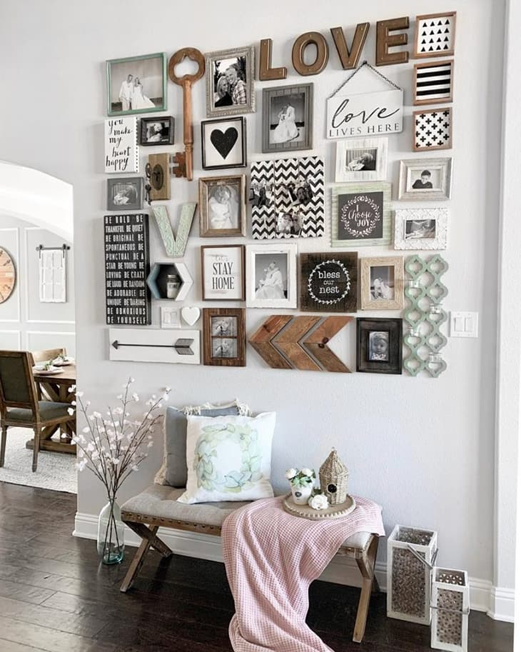 farmhouse gallery wall with chevron arrows, wooden key, rustic frames, love sign