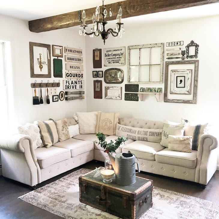 farmhouse living room gallery wall with window pane over sectional sofa