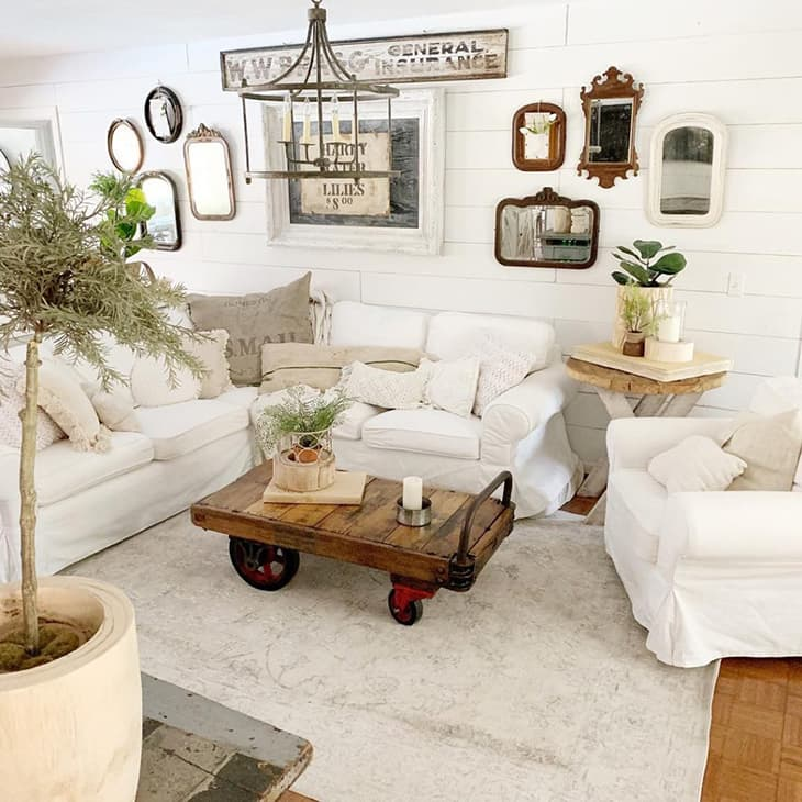 farmhouse gallery wall with mirrors over sectional sofa