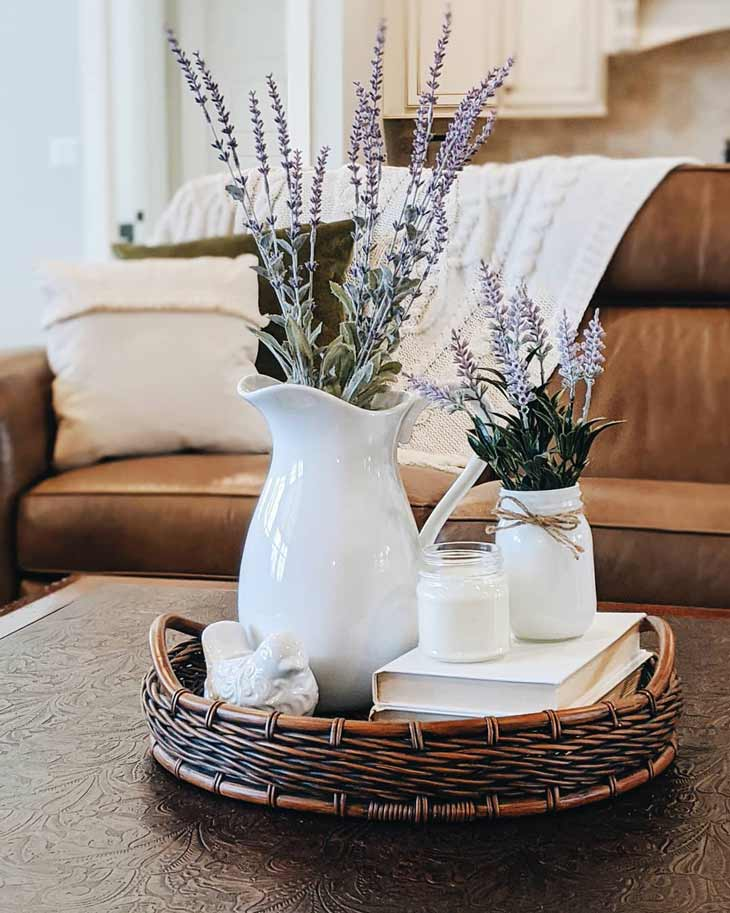 coffee table decor with basket tray, white pitcher and lavender