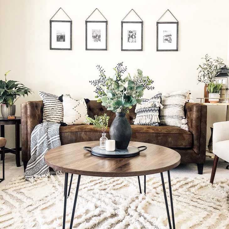round coffee table centerpiece with serving tray and black vase