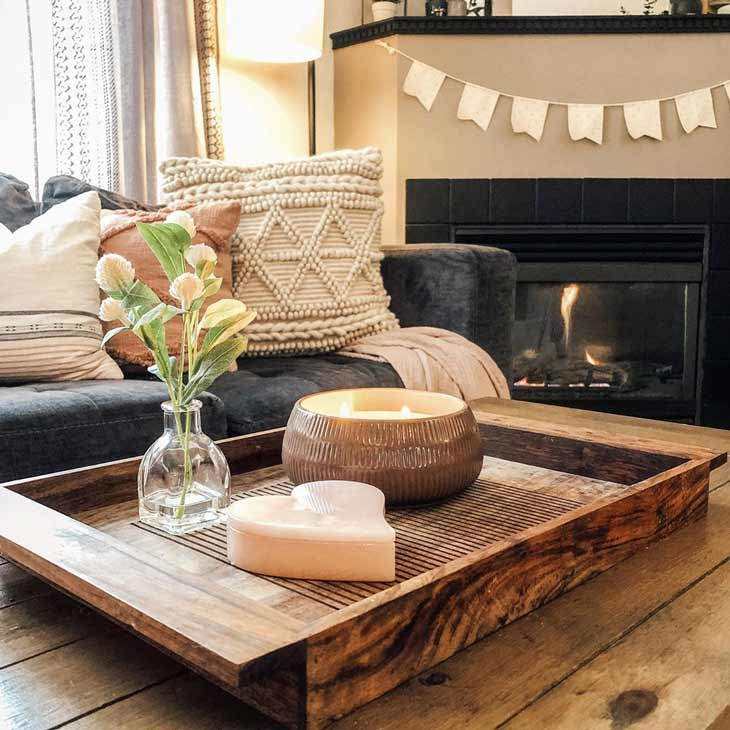 coffee table decor with wooden tray, candle and small vase