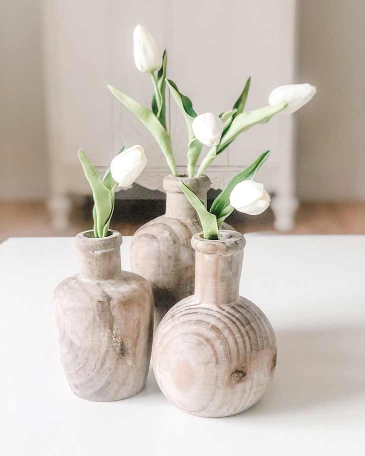 coffee table decor with wooden vases and artificial white tulips