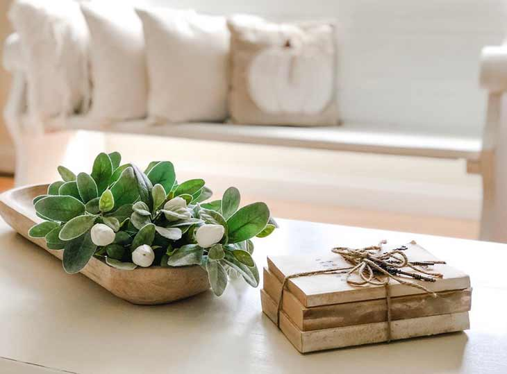 coffee table decor with decorative books and oval serving tray with artificial tulips