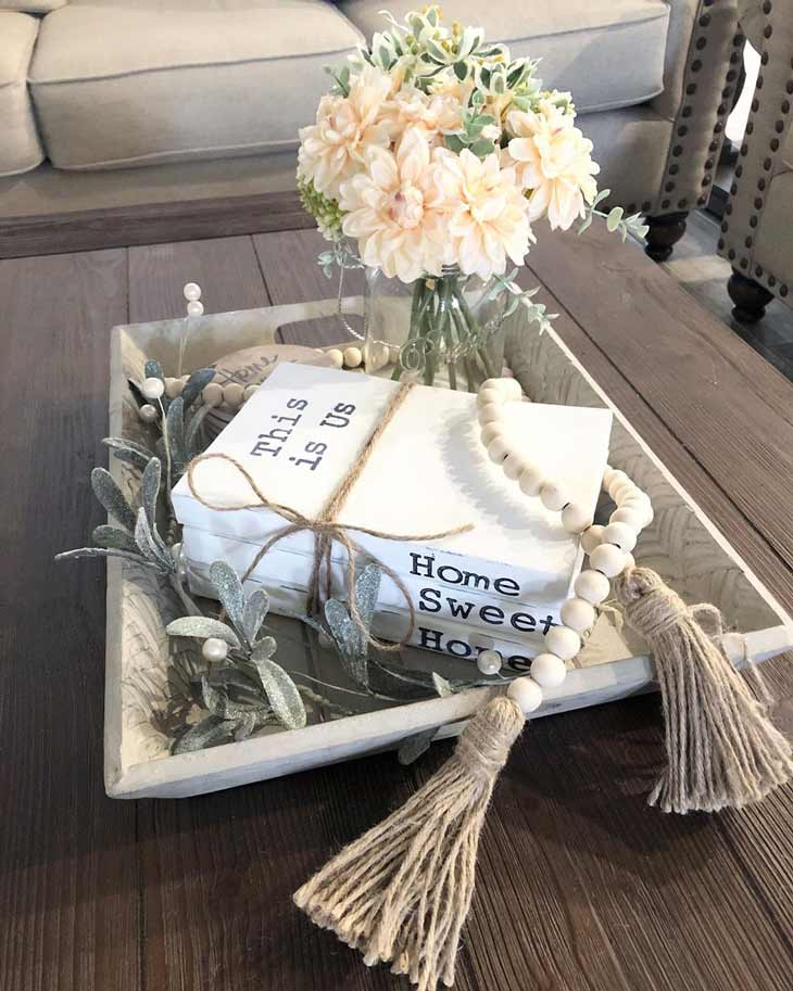 coffee table decor with wood tray, fresh flowers, bead garland and decorative books