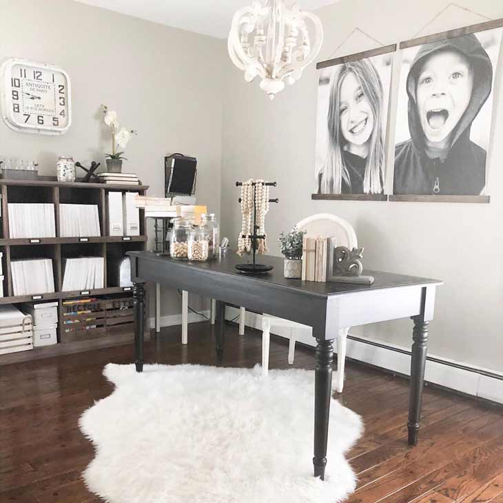 home office with black desk and storage