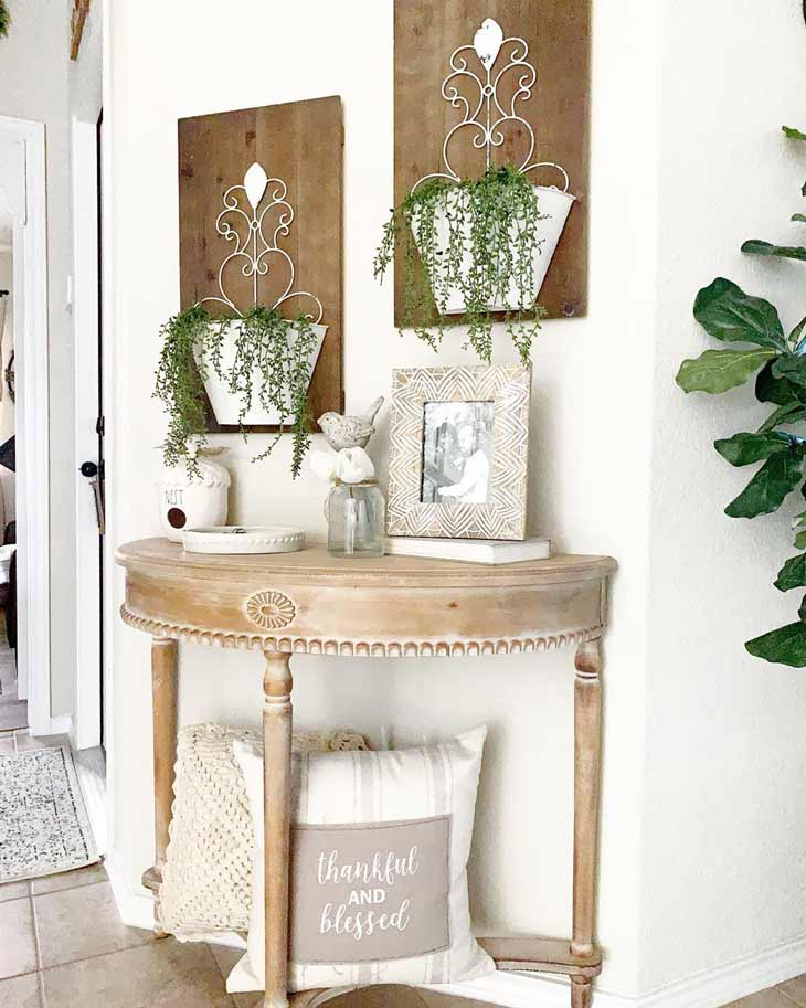 Half round entryway table with pillow decor for small entryway