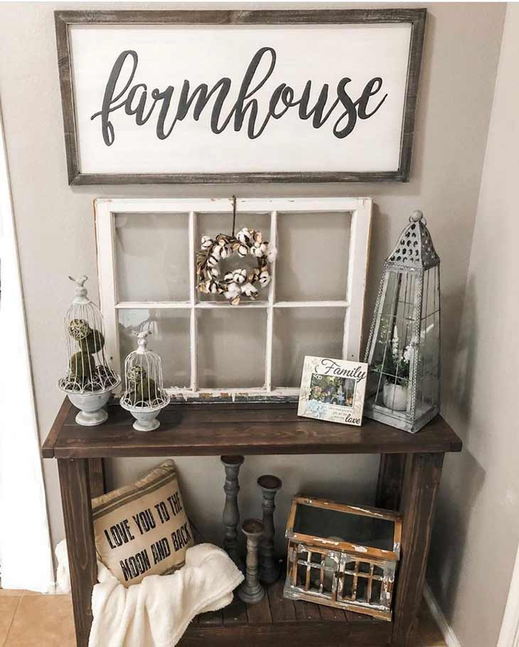 small wooden entryway table with rustic decor and farmhouse sign