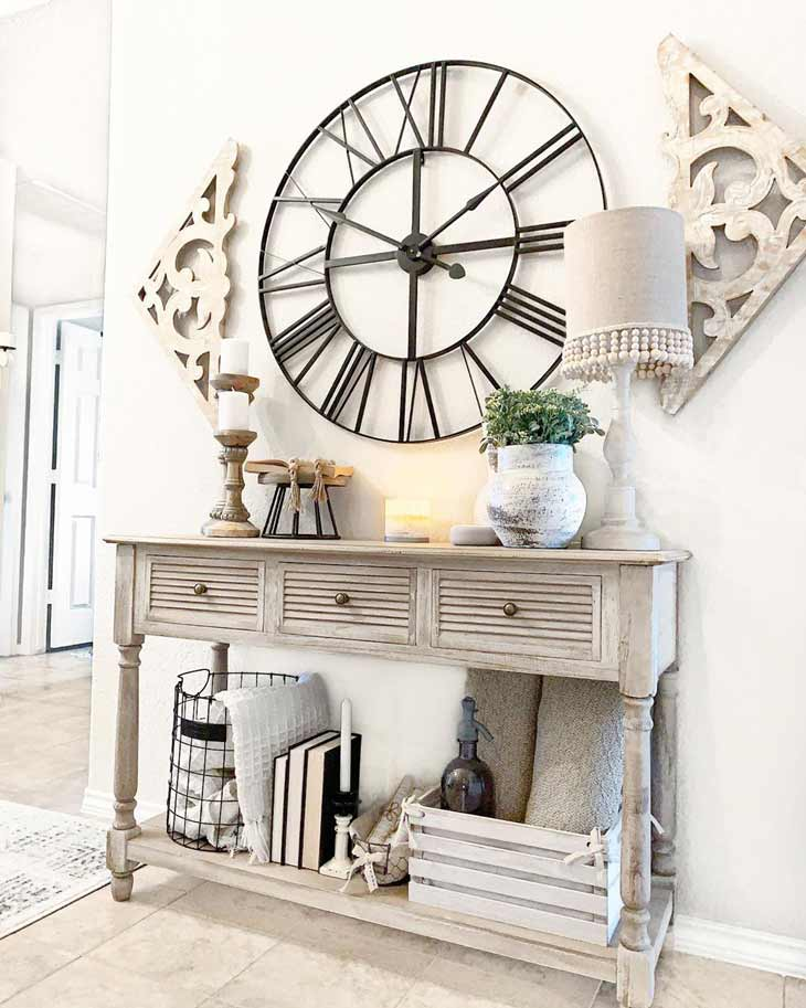 Farmhouse entryway table decor with big wall clock and storage