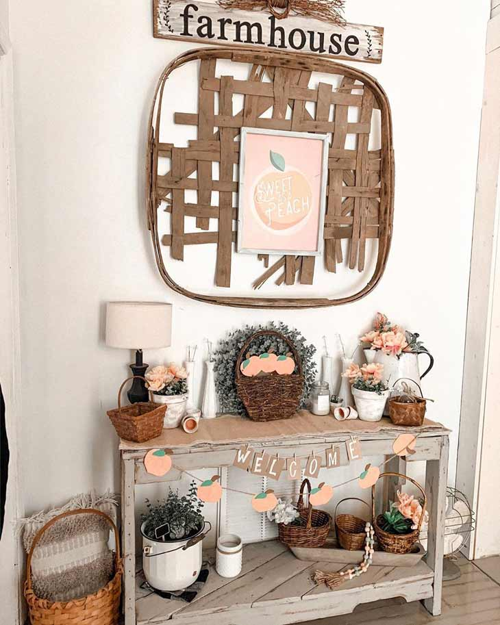 rustic entryway table decor with tobacco basket decor and farmhouse sign