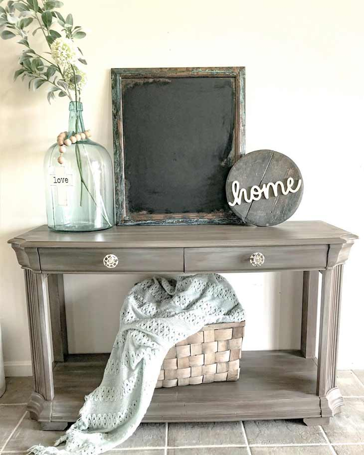 Entryway table with rustic decor