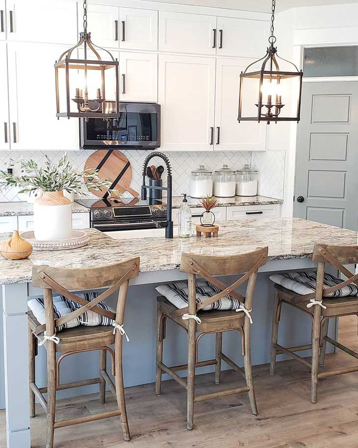 kitchen rustic lantern pendant lights over kitchen island with wood bar-stools
