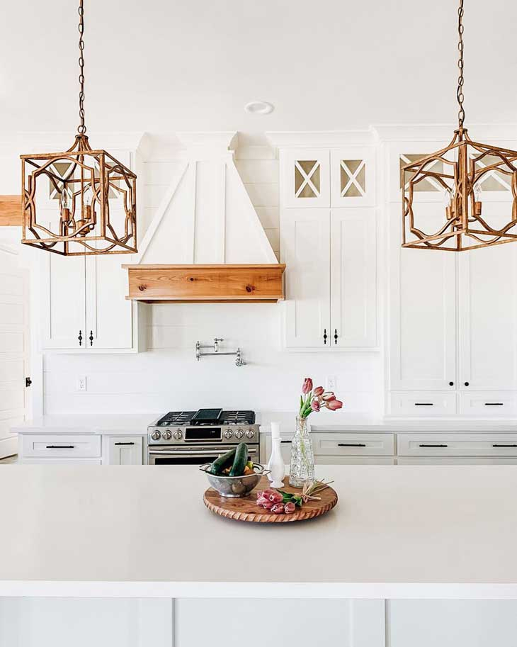 gold metal pendant lighting in white modern farmhouse kitchen