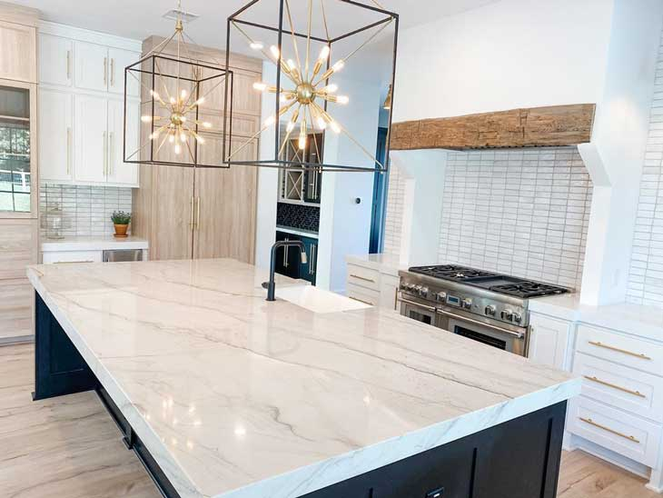 modern pendant lighting over white marble countertop