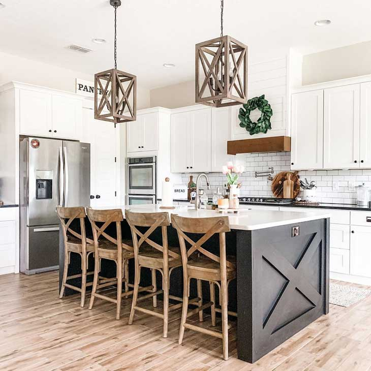 square wood pendant lighting for black kitchen island with wood barstools in modern farmhouse kitchen