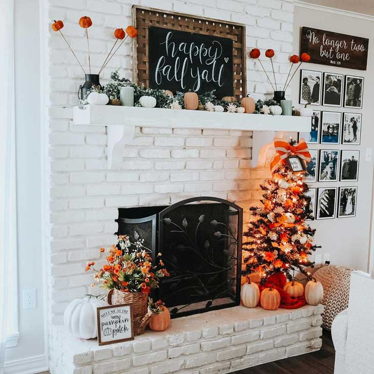 White brick fireplace with fall decor