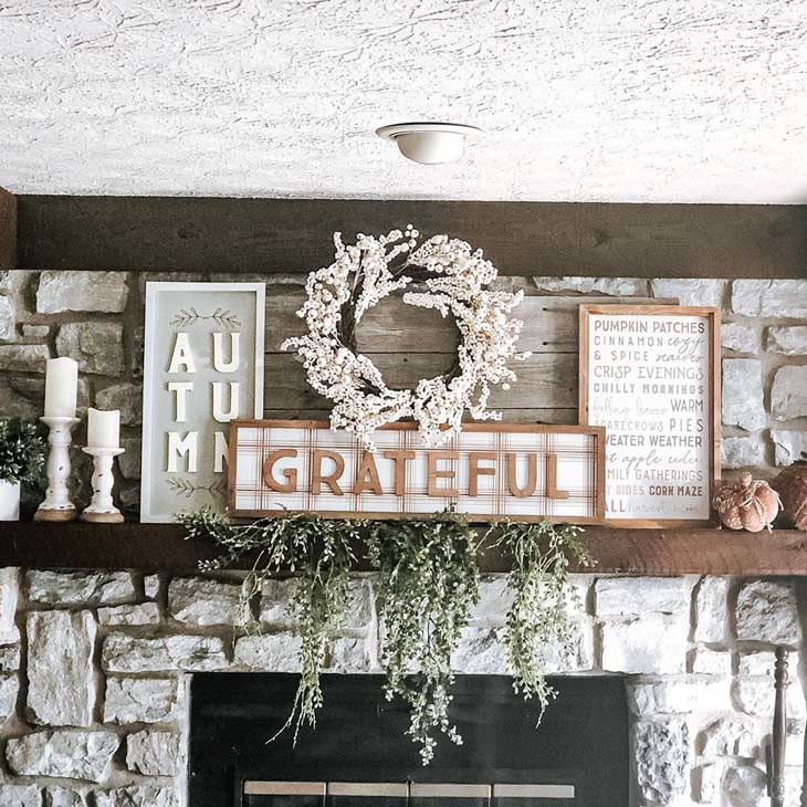 White stone fireplace with neutral decor