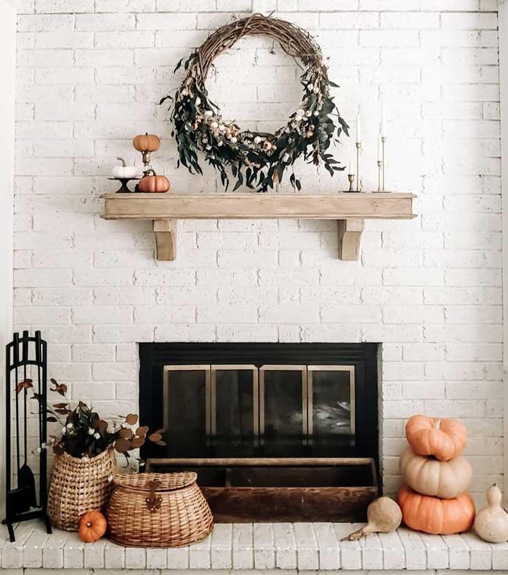 White brick fireplace with fall mantel decor