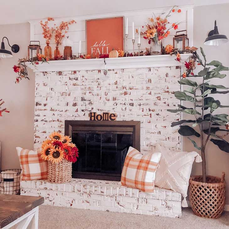 Whitewashed fireplace with fall decor