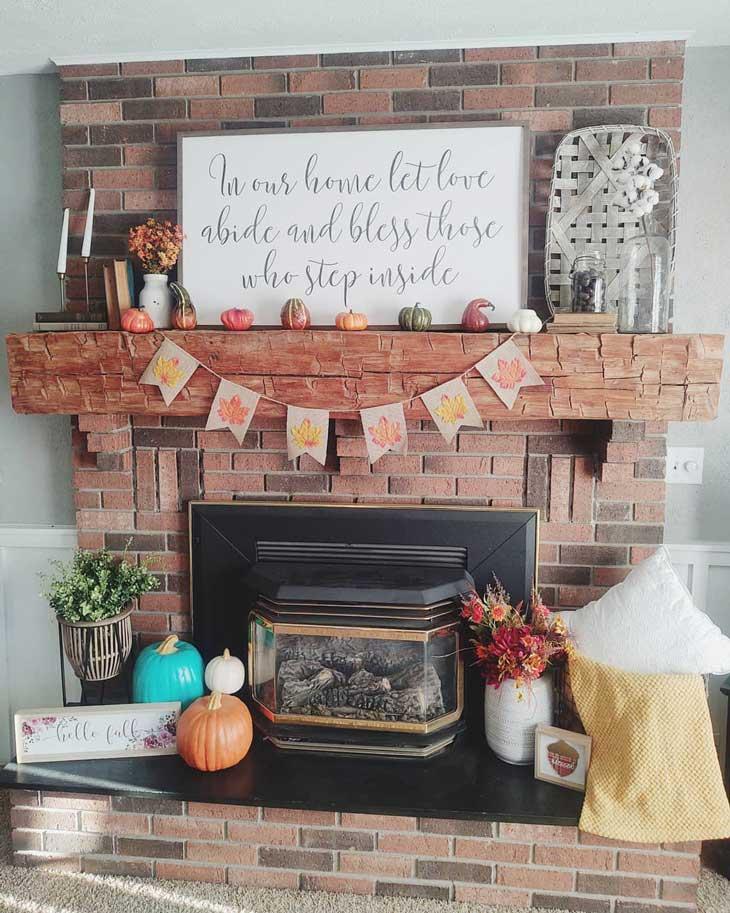 Fall mantel decor on a red brick fireplace
