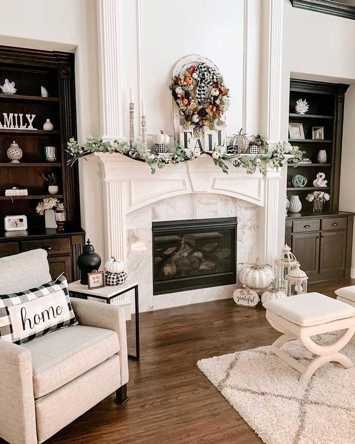 Modern farmhouse fireplace with fall decor