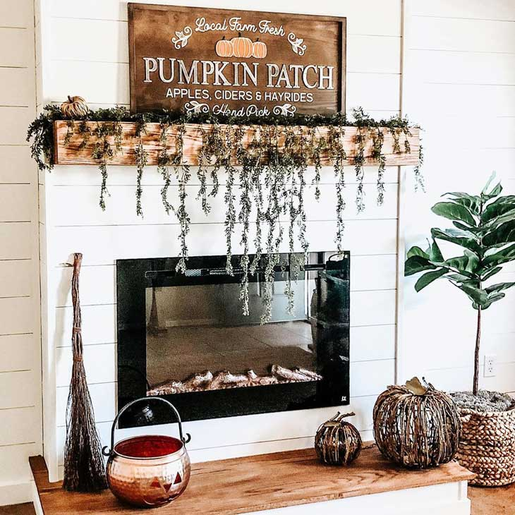 White shiplap fireplace with fall decor