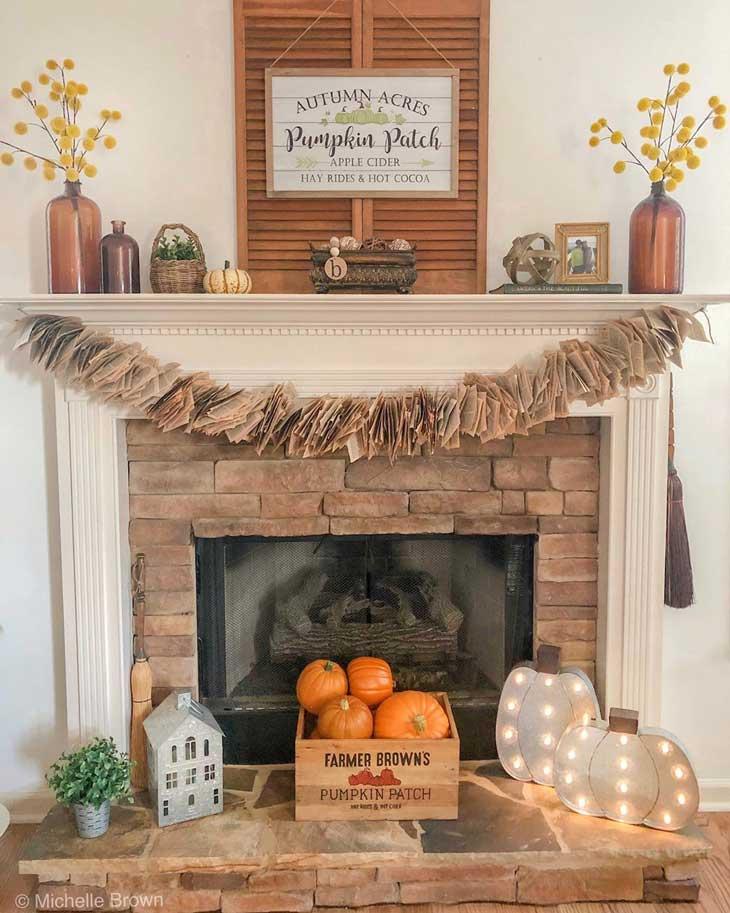 fall mantel decor on whtie fireplace
