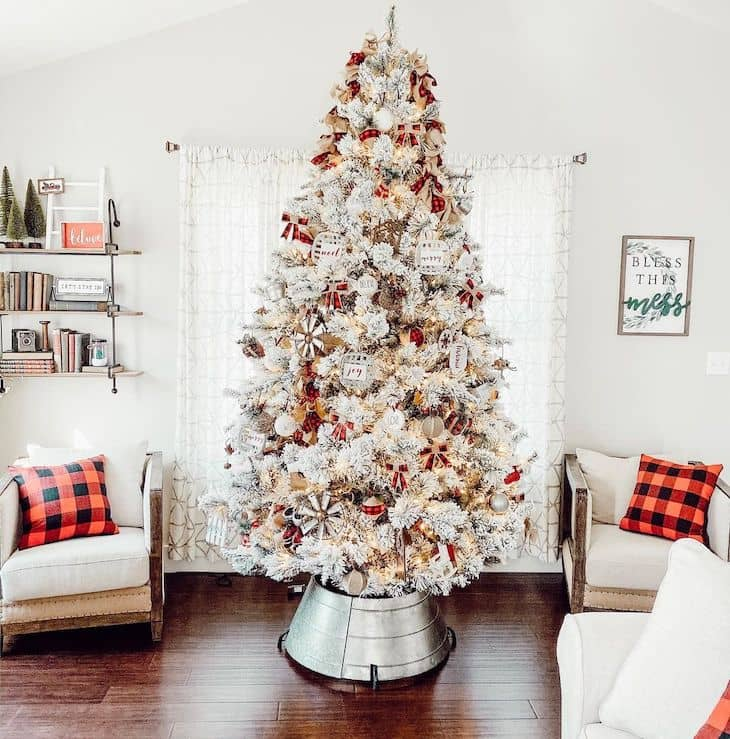 Red and white Christmas tree decor with red buffalo check ornaments and galvanised tree skirt
