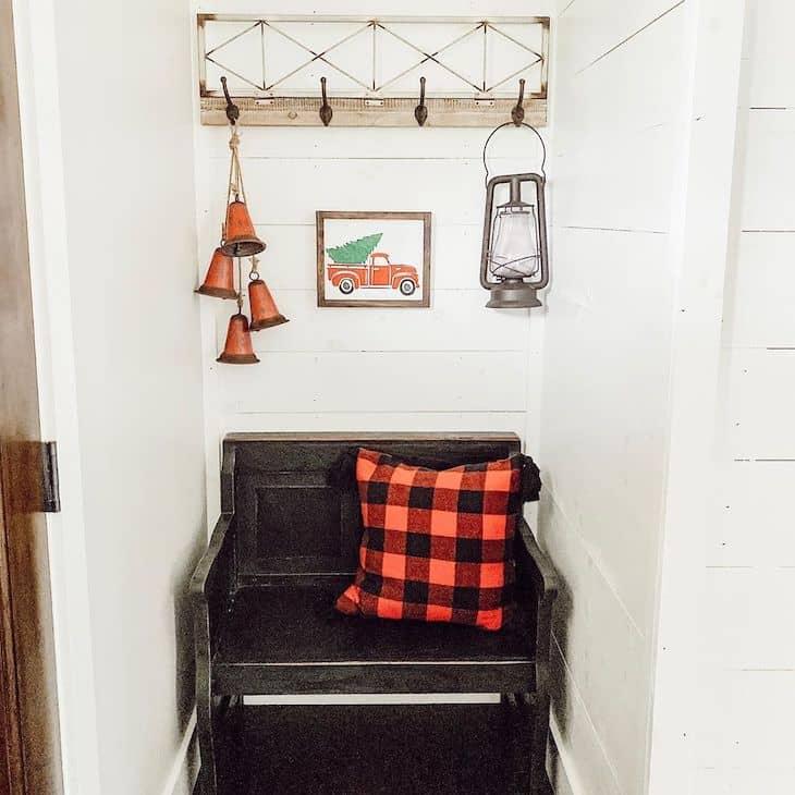 Christmas entryway bench with buffalo check pillow