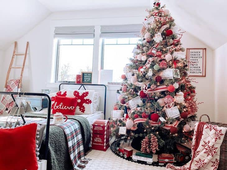 Red and white Christmas tree for kids  attic room with black metal bed