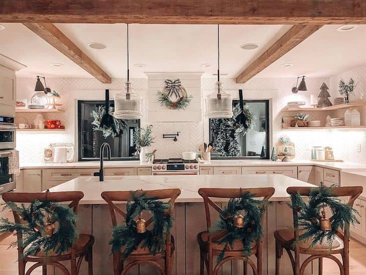 Kitchen Christmas decor with wreaths on high chairs