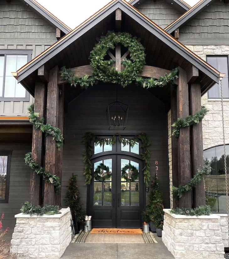 Christmas decor for double black front door with garland and wreaths