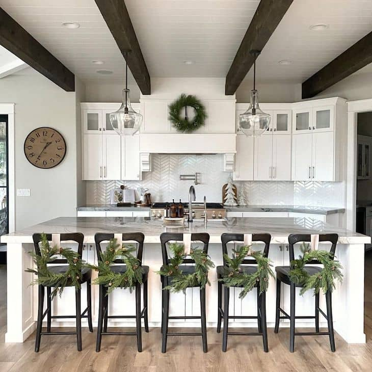 White kitchen with black counter stools with Christmas decor